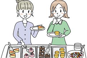 ビュッフェのデザートを楽しんでいる二人の女性の画像